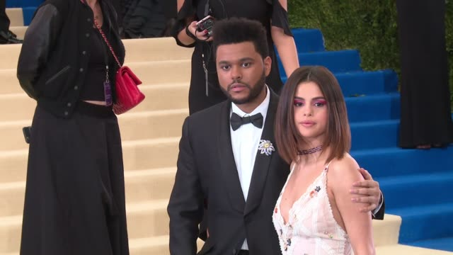 the weeknd and selena gomez at rei kawakubo/comme des garcons art of the inbetween costume institute gala arrivals at the metropolitan museum of art... - selena gomez stock videos & royalty-free footage