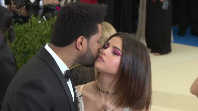 the weeknd selena gomez at rei kawakubo/comme des garcons art of the inbetween costume institute gala arrivals at the metropolitan museum of art on... - selena gomez stock videos & royalty-free footage