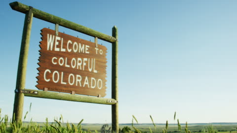 """the """"welcome to colorful colorado"""" state line sign on the colorado/wyoming border at sunset - welcome sign stock videos & royalty-free footage"""