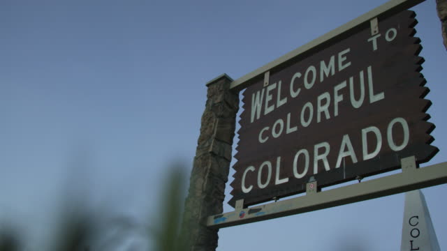 "the ""welcome to colorful colorado"" state line sign on the colorado/utah border on interstate 70 at sunset - welcome sign stock videos & royalty-free footage"