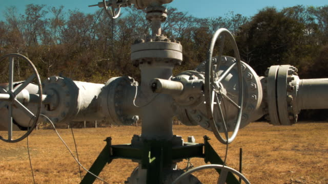the well head and pipes that pull steam out of the earth to be piped to a geothermal power plant run by the costa rican electricity institute are... - anatomical valve stock videos & royalty-free footage