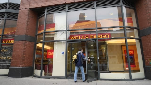 the wells fargo bank is on broadway at the corner of w70th st in manhattan new york close up shots of wells fargo signage hanging in the window of... - the bank of new york stock videos and b-roll footage
