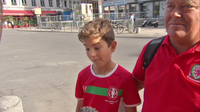 vídeos de stock, filmes e b-roll de the welsh national football team made it as far as the semifinal in the uefa euros 2016 but lost to portugal vox pops with welsh football fans - euro 2016