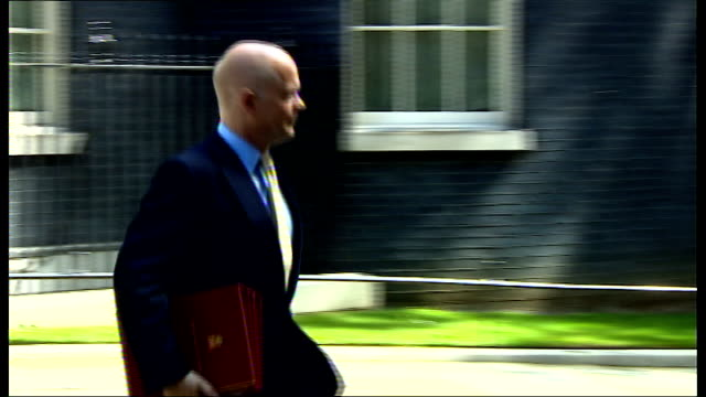 the west and iran drawn together by threat from isis extremists downing street ext william hague mp along from number 10 to car - isis stock videos and b-roll footage