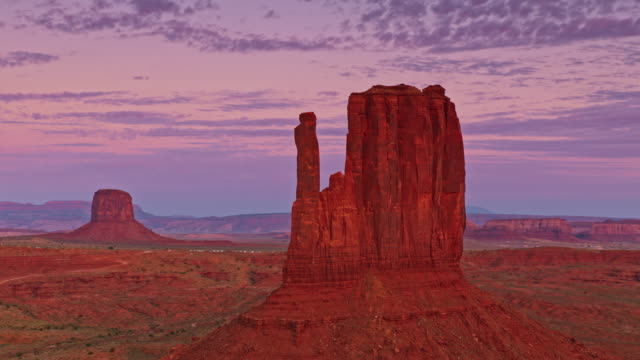 aerial the west mitten butte in monument valley at sunrise - mitten stock videos and b-roll footage