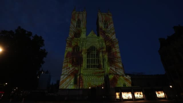 the west towers of westminster abbey have been illuminated to mark the 150th anniversary of the death of charles dickens. - charles dickens bildbanksvideor och videomaterial från bakom kulisserna