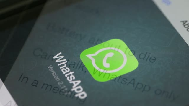 the whatsapp inc mobilemessaging application whatsapp and the facebook inc application are displayed along with other apps on an apple inc iphone in... - messaggistica online video stock e b–roll