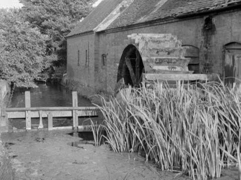 the wheel of a water mill turns - water wheel stock videos and b-roll footage
