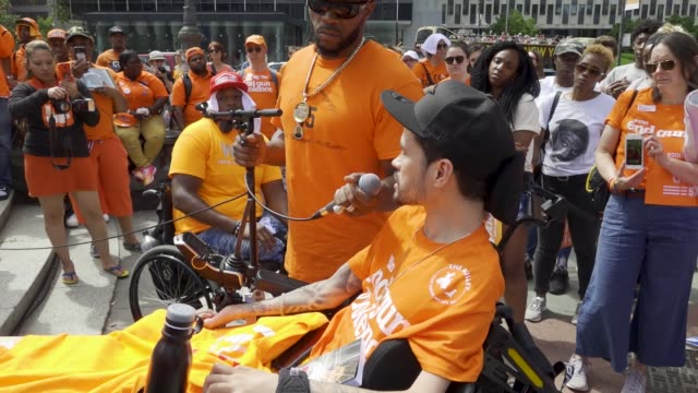the wheelchair bound speaker is from wheelchairs against guns national gun violence awareness day is the first friday in june people rallied at... - disability awareness stock videos & royalty-free footage