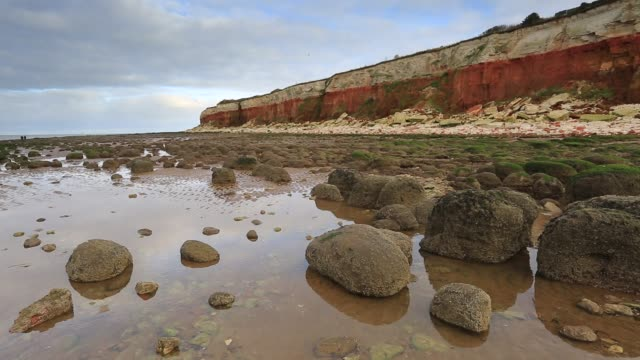The white chalk and red limestone cliffs, Hunstanton town, Norfolk, England, UK