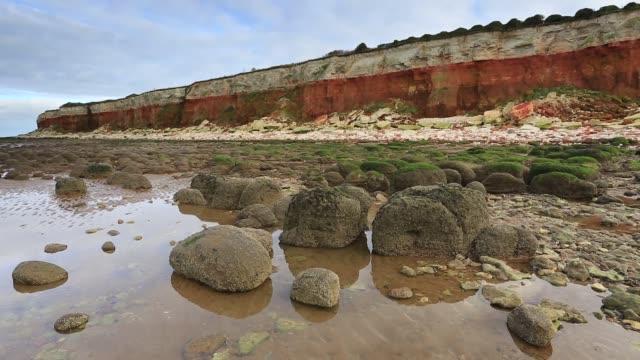 The white chalk and red limestone cliffs, Hunstanton town, Norfolk, England, UK