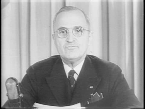 the white house / president harry s truman speaks on the surrender of germany / people gather in the churches / packed cathedrals / thousands fill... - arrendersi video stock e b–roll