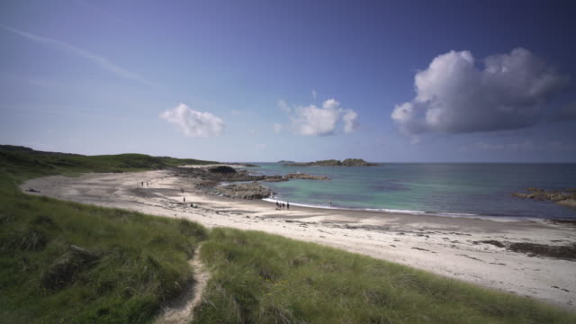 the white sandy beaches and clear blue water on the island of iona, scotland - hebrides stock videos and b-roll footage