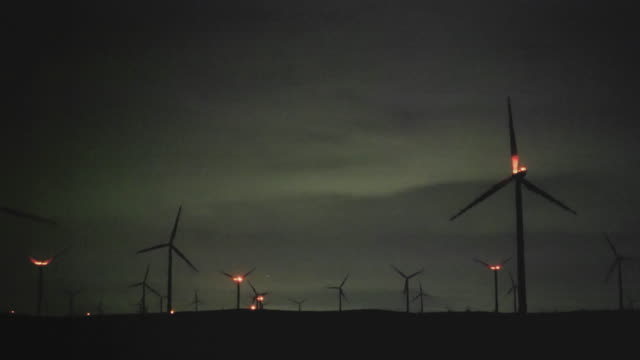 The wind power farm in California at the night.
