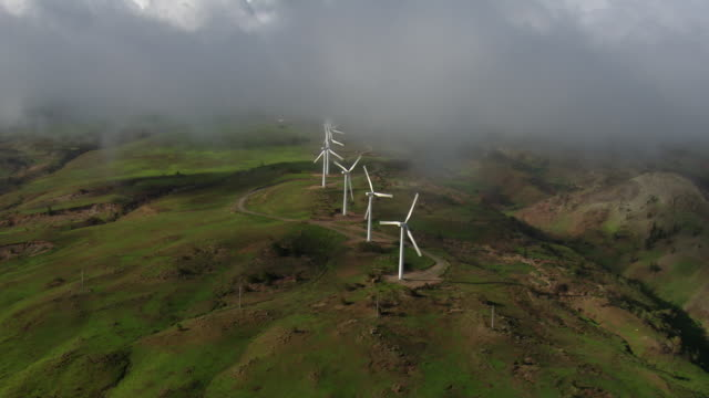 The wind turbines of the Kaheawa windfarm rotate, creating a renewable and local power supply on the Hawaiian Island of Maui.
