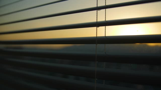 the window blinds with sunrise - shade stock videos & royalty-free footage