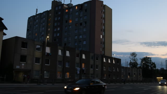 the windows of a high-rise apartment building struck by a covid-19 outbreak are illuminated at twilight on june 21, 2020 in goettingen, germany.... - fensterfront stock-videos und b-roll-filmmaterial