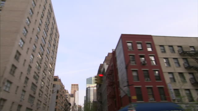 the windows of manhattan high-rises reflect the sky and nearby buildings. - manhattan video stock e b–roll