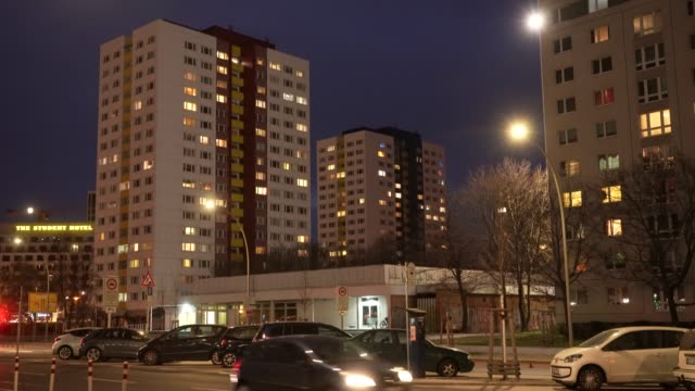 the windows of residential apartment buildings are illuminated towards evening as the broadcast tower at alexanderplatz stands behind on march 20 in... - flat stock videos & royalty-free footage