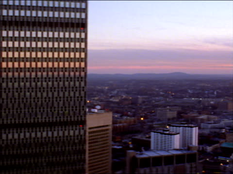 the windows of the prudential tower office building reflect a golden hour sky. - boston massachusetts stock videos & royalty-free footage