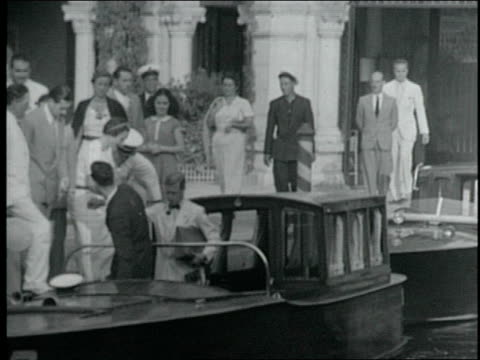 the windsors during their travels including their honeymoon on a venetian canal boat in beach attire and in a rowing boat duke of windsor and wallis... - wallis simpson stock videos & royalty-free footage