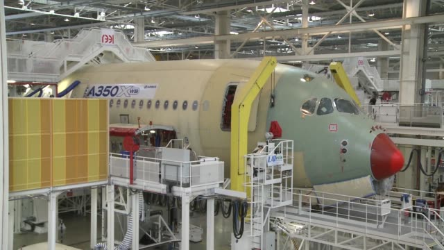the wingtip tail fin of an airbus a350 wide-body aircraft, a unit of european aeronautic, defence & space co. , is seen on the company's assembly... - toulouse stock videos & royalty-free footage