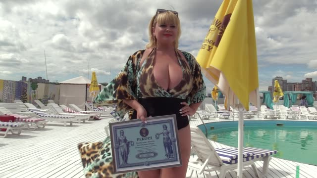 the winner mila kuznetsova with 13th breast size poses with her a record's certificate during the ukrainian record in a nomination 'the largest... - plus size model stock videos & royalty-free footage