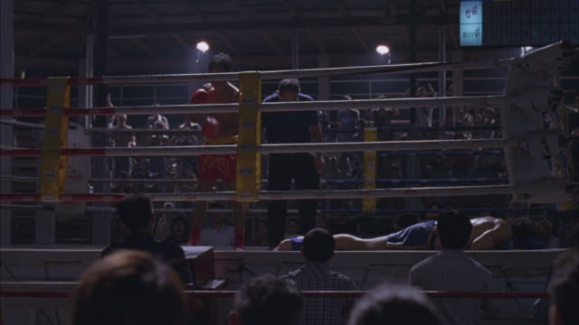 the winner of a boxing match bows to a cheering audience. - boxing ring stock videos & royalty-free footage