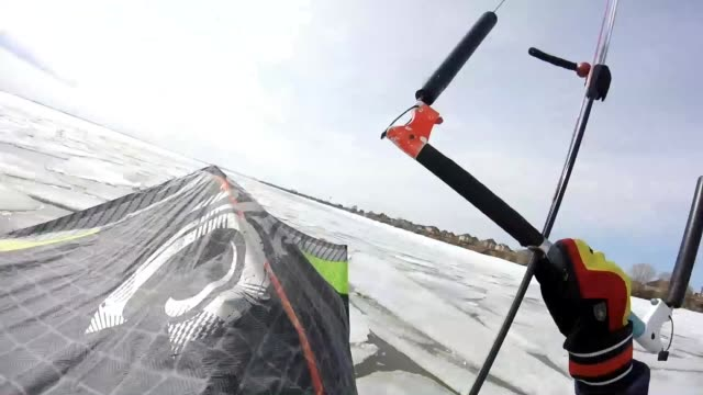 the winter season has come to an end but that doesn't mean you can still make the most of the ice that's still there kite skating looks intense - altri temi video stock e b–roll