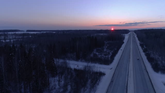 the winter sunset over the highway. - horizon stock videos & royalty-free footage
