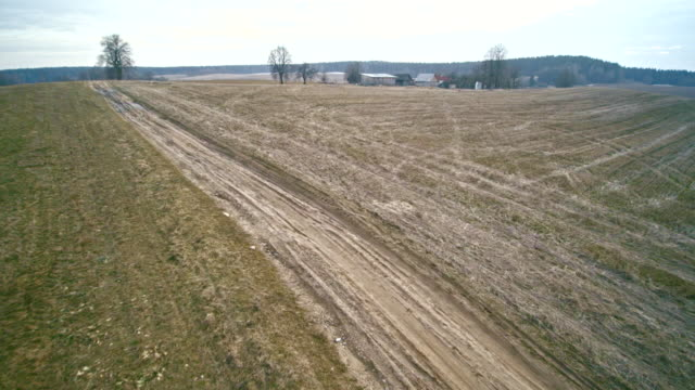 the winter's rural landscape. the dirty country road in the fields. aerial view. - hay stock videos and b-roll footage