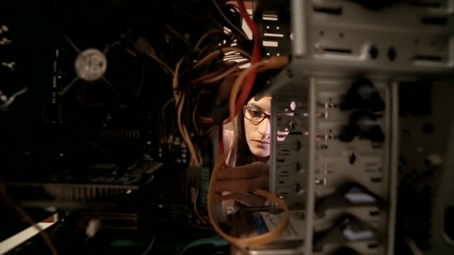 the woman fixes the computer - aggiustare video stock e b–roll