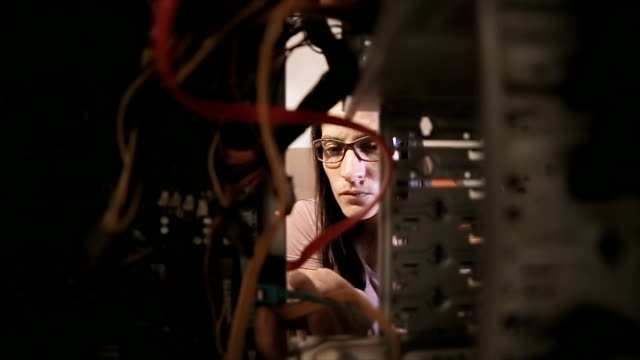 the woman fixes the computer - repairing stock videos and b-roll footage