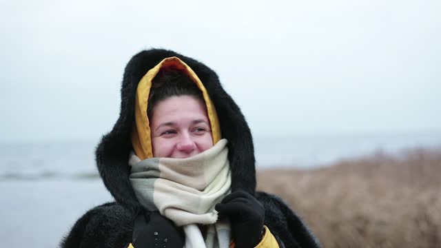 the woman froze while walking in the winter. - winter coat stock videos & royalty-free footage
