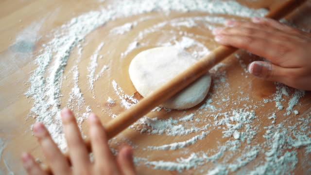 the woman preparing turkish traditional food mantı (turkish ravioli) - rolling pin stock videos & royalty-free footage