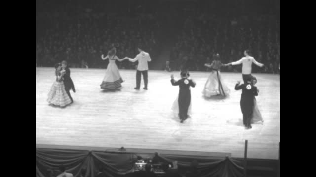 vídeos de stock e filmes b-roll de the women in gowns and men in white tie and tails perform at the harvest moon ball dance contest on a ballroom dance floor in the middle of madison... - cintura