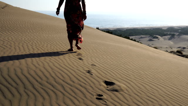 the women walking on the sand - middle east stock videos & royalty-free footage
