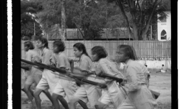the women's regiment of the indian national army practice flag signals bayonet drills and then issue an exhortation after a speech from a leader... - bayonet stock videos and b-roll footage