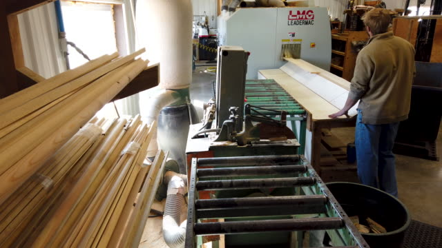 the woodworkers shoppe employees laverne yoder and jethro yoder stain and stack boards of custom tongue-and-groove paneling made from mountain pine... - wood stain stock videos & royalty-free footage