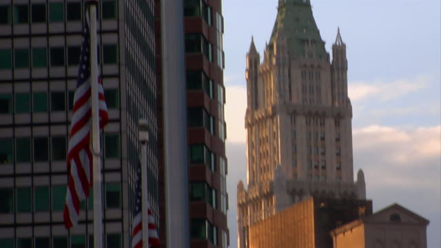 the woolworth building stands tall in downtown manhattan. - woolworth building stock videos & royalty-free footage