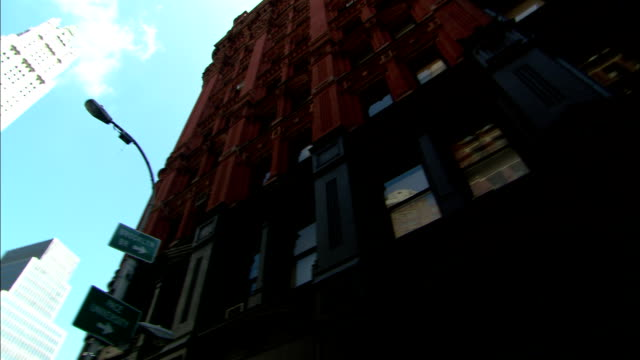 the woolworth building towers over adjacent high-rises in new york city. - woolworth building stock videos & royalty-free footage
