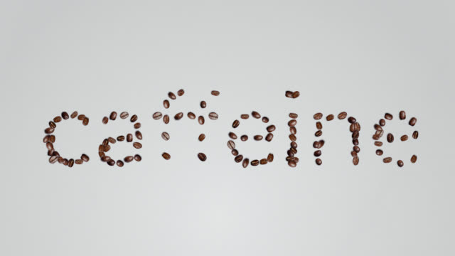 the word caffeine shaped coffee bean on white background - caffeine stock videos & royalty-free footage