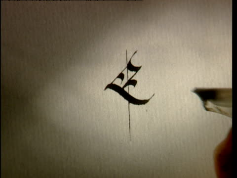 the word, excalibur is carefully written in calligraphy. - pen stock videos & royalty-free footage