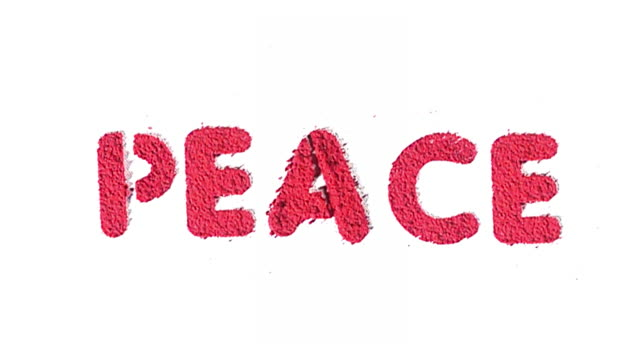 The word peace exploding in red text made from powder.