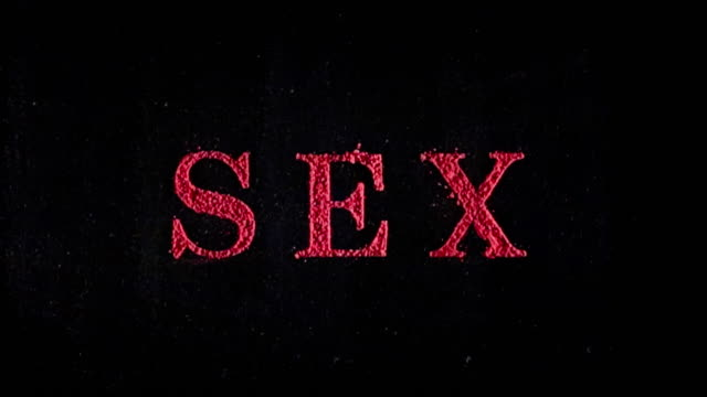 vídeos de stock e filmes b-roll de the word sex written in red exploding text - david ewing