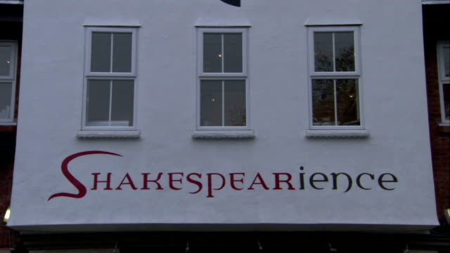the word shakespearience decorates the awning of a store. available in hd. - awning stock videos & royalty-free footage
