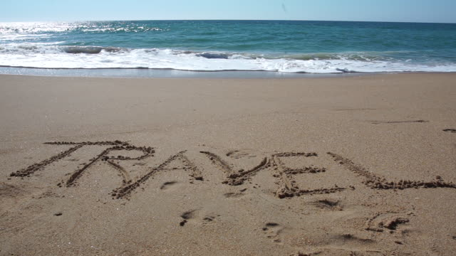 "the word ""travel"" written in the sand - silvestre stock videos & royalty-free footage"