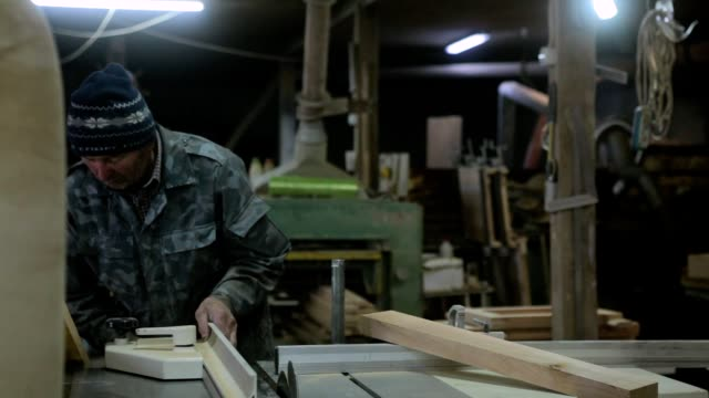 the worker processes the pine board on the workbench. - measuring stock videos & royalty-free footage