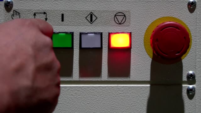 the worker's hand switching on the machine start button, close up - switch stock videos & royalty-free footage