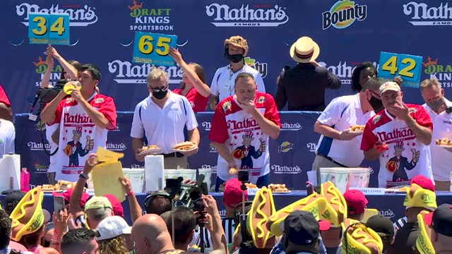 the world champion joey chestnut renewed his own world record on sunday, july 4, by eating 76 hot dogs and buns in only 10 minutes in the world... - 14 15 years stock videos & royalty-free footage